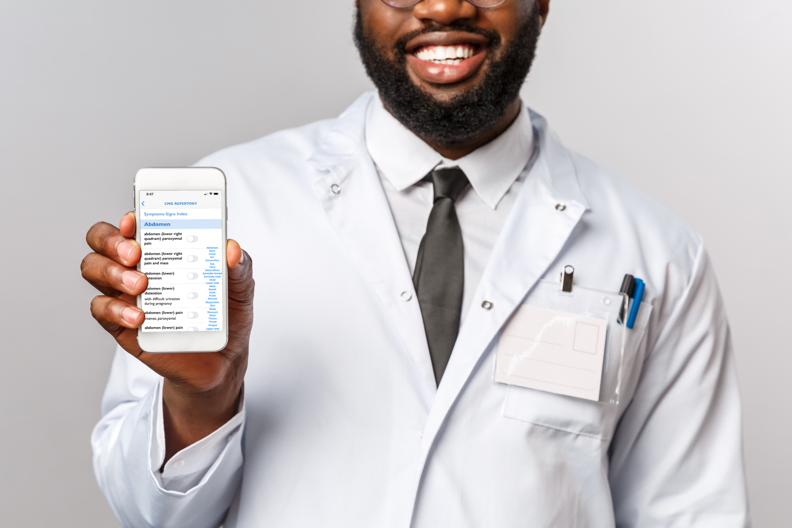 African doctor holding phone with CMD app